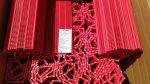 INTRALOX Series 200 modulszalag, modul rendszerű élelmiszeripari szállítószalag, műanyag futószalag, piros Polipropilén, 561mm széles, flush grid felület, 50,8x192 mm modulokból, (102)